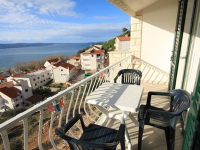Photo for Two bedroom apartment with balcony and sea view Duće (Omiš) (A-7532-b)