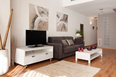 Flat screen TV and sofa bed