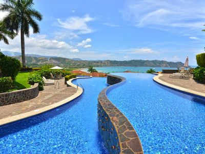 Relax and take up the sun at the infinity pool located at the hilltop of Los Sueños