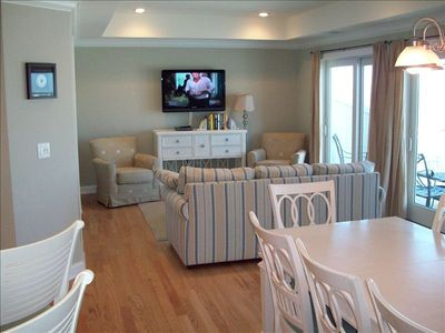 Spacious Living Room, Dining Room and full length patio deck on the main level