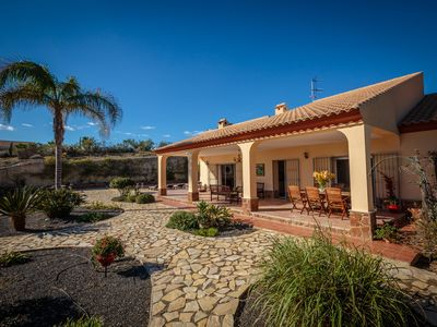 Photo for Tranquil luxury Villa. 4 bedrooms, large pool, bar, sea views, huge garden