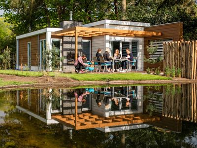 Photo for Modern and detached holiday home for four persons with jacuzzi.