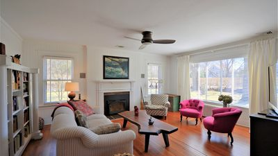 Photo for New Listing: Bright, Cozy & Near Beach w/ Heated Pool, Screened-in Porch and Beautiful Landscaping