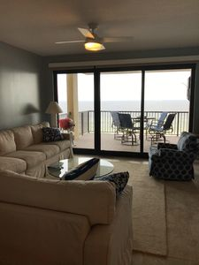 Living area and patio overlooking Gulf of Mexico.