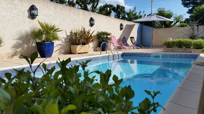 Photo for Villa at the foot of conditioned town secure patio pool for children