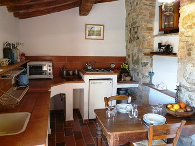 Photo for Lovely Cottage villa with Swimming Pool and Views Over Olives, Vines and Forest