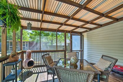 Take advantage of the home's screened-in and covered porch with a gas grill!