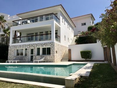 Photo for Contemporary and generous 4/5 double bedroom villa overlooking golf course