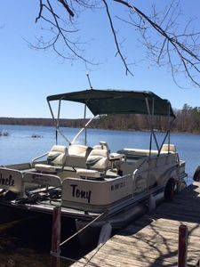Enjoy fishing and swimming on this beautiful included pontoon boat!