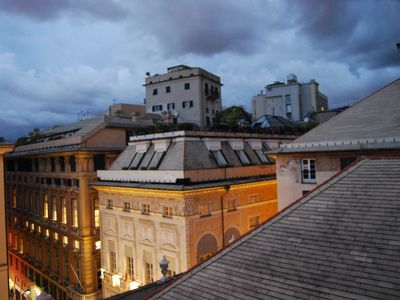 Photo for Elegant studio apartment overlooking the rooftops of Genoa has air conditioning