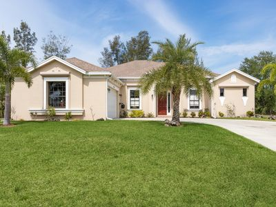 """Photo for """"TOP NOTCH"""" Spacious """"freshwater canal-side Florida retreat, a tropical paradise"""