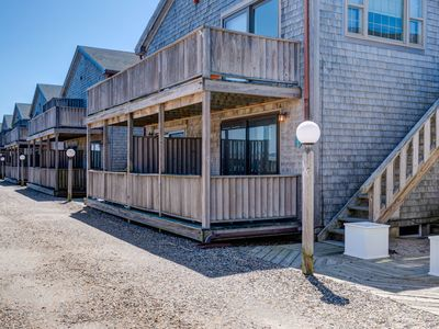 Photo for NEW LISTING! Beachy condo w/private, shaded deck - 1/2 block to the beach!