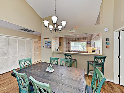 Dining Area - For group meals, gather at the 6-person dining table, with room for 2 more at the kitchen bar.