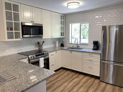 Photo for Spacious 2bed Condo. Heated Pool. 14min to Beach!