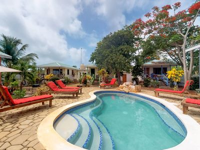 Photo for NEW LISTING! Wood cabana w/ porch and pool views, shared common area and grills