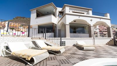 View of luxury villa and terrace.