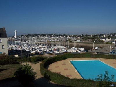 Photo for Very bright. Well equipped. Magnificent views of pool and harbor