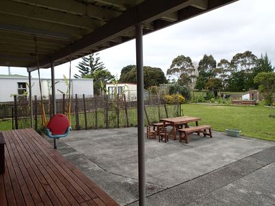 enclosed garden safe for children with swing and slide great outdoor BBQ area