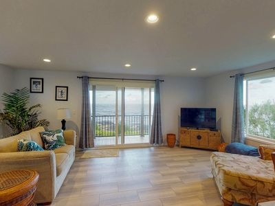 Photo for Stunning waterfront home w/ a private hot tub, full kitchen, & three lanais!