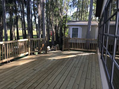Photo for Home with garage and deck overlooking lake and golf course