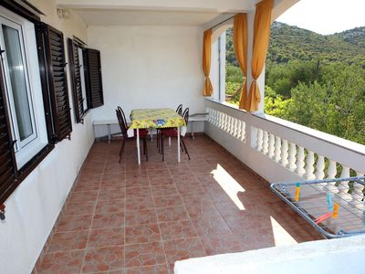 Photo for Two bedroom apartment with terrace and sea view Vrgada (Biograd)