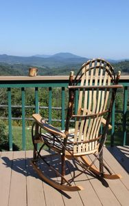 Relax with coffee and a rocking chair on the back deck.