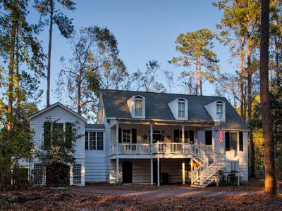 Photo for A lovely home with expansive porches, overlooking Lake Best.  Relax, Recharge!