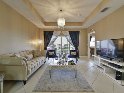 Photo for Sophisticated Naples Lakefront Condo - Top Floor