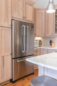 Updated Kitchen With Marble Countertops & Stainless Appliances