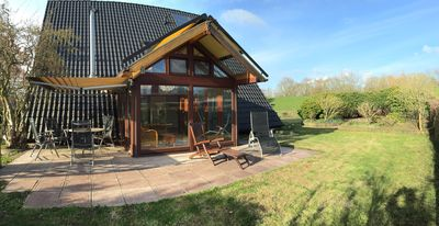 Photo for Large holiday home on the dike with conservatory, garden, barbecue area ...