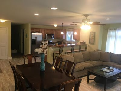 Living room and kitchen areas with new flooring - eating for 10 total