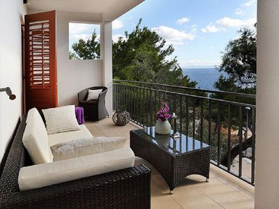 Photo for Two bedroom apartment with terrace and sea view Sveta Nedilja (Hvar) (A-17139-d)