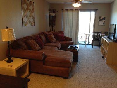 Great living area to relax with large sectional, hdtv,, dvd, wifi, & balcony