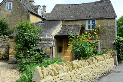 View of house from Front. Surrounded by authentic Cotswold Stone Wall.