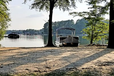 Beach your pontoon boat & wave runner or tie-up your v-hull just off shore.