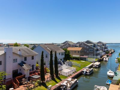 Photo for Canal-front condo w/ deck and furnished balcony offering bay views