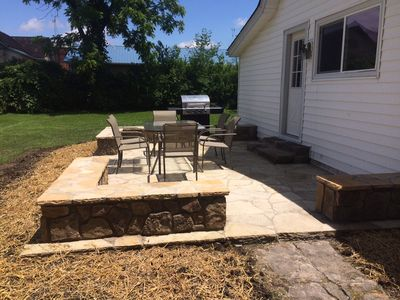 The new flagstone patio with stone sitting walls offers plenty of seating.