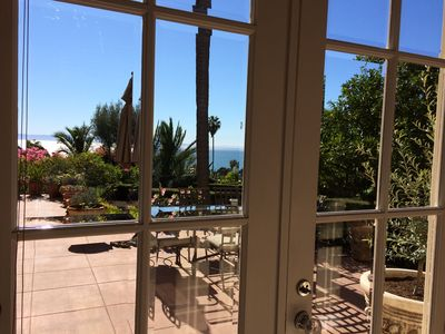 View from inside hallway to patio and ocean view.