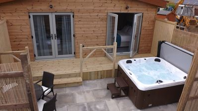 Photo for 2 bedroom Luxury chalet/bungalow Hot tub and private Terrace on adult only site
