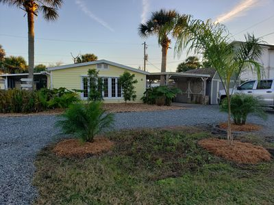 Photo for Walk to private beach from this cozy, pet friendly cottage in the Hammacks!