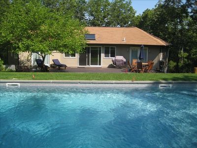 Swimming pool with view onto main deck, off living room