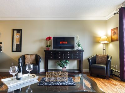 Photo for Modern Downtown Condo -4 Mins to Rogers Place -Free Underground Parking & NFLX! Sanitized!