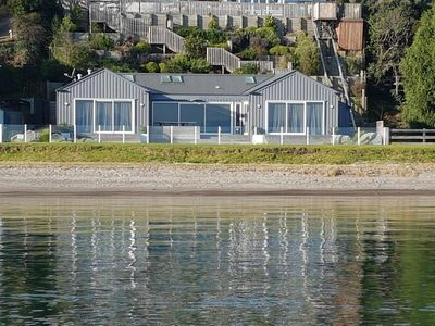 Photo for Waterfront House - located directly on the beach and overlooking the mountains
