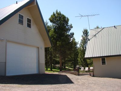 Large heated garage and patio behind main cabin