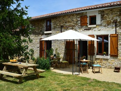 Photo for Attractive 18th century stone holiday home with patio and large enclosed garden.