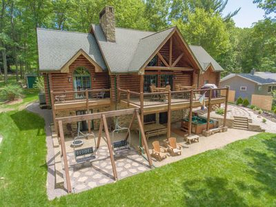 Lakefront home with dock slip, hot tub fire pit and pool table!