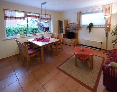 Photo for Cosy ground floor apartment in the village, south-facing terrace with a beach chair