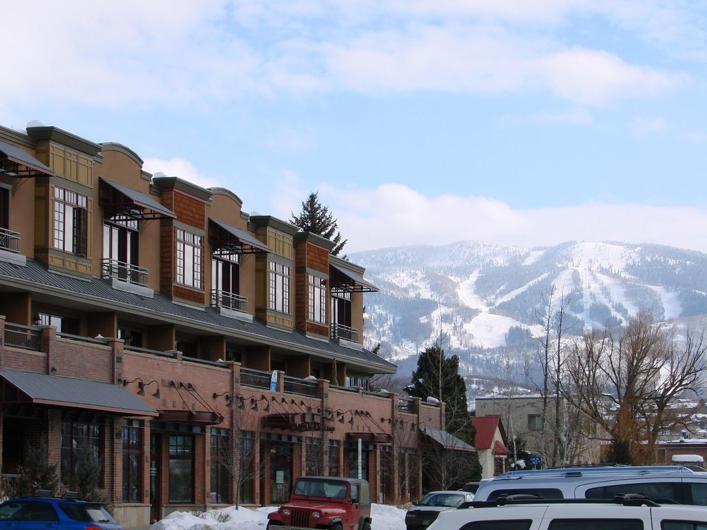 Waterside Village is downtown on the river. Catch the free bus to the ski area.