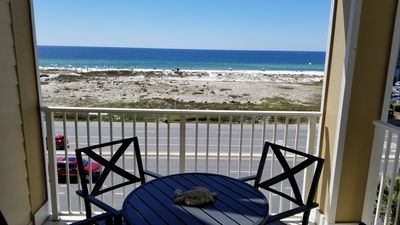 Photo for GRAND CARIBBEAN 403 OCEAN VIEW. BEACH IS ACROSS STREET AND BOAT LAUNCH IS BEHIND COMPLEX.THIS UNIT HAS A  POOL VIEW.