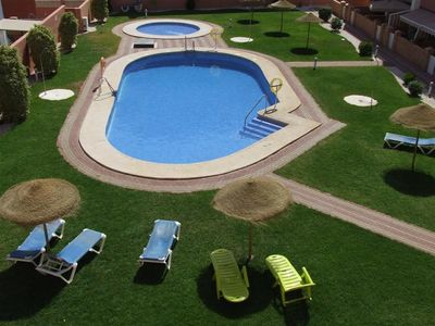 Fabulous pool area with main pool, splash pool, free sunloungers and parasols